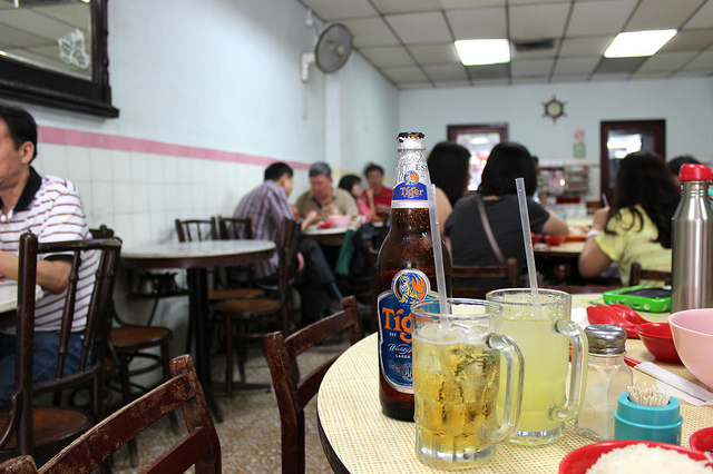 Tiger beer and lime juice on ice at Yet Con restaurant in Singapore (WBEZ/Louisa Chu)