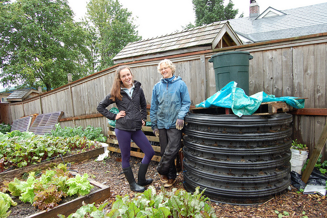 Sitka Local Foods Network intern Christine Devlin and lead gardener Laura Schmidt with compost (WBEZ/Louisa Chu)
