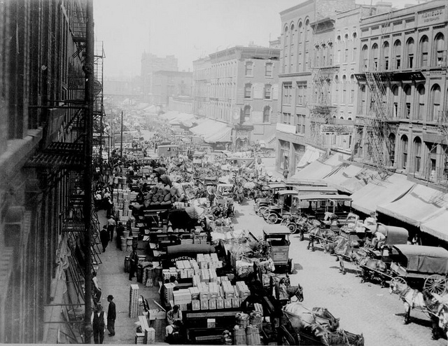 Looking west on South Water Street, Chicago, crowded with horse-drawn wagons and motor trucks filled with produce for market, April 1915. (Courtesy of the National Archives)
