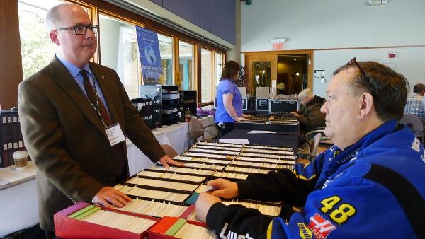 Kellerman talks to a customer at the American Stamp Dealers Association's show in Lombard. (Shannon Heffernan/WBEZ)