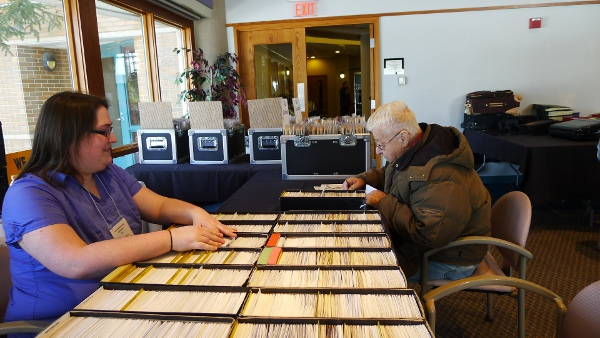 Megan Kellerman assist her father at a stamp show (Shannon Heffernan/WBEZ)