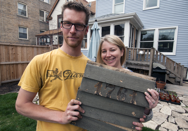 Paul Toben, left, and Jessica Fisch, right, discovered their old house number while fixing up the place they recently bought in Chicago's Edgewater neighborhood. (WBEZ/Chris Bentley)