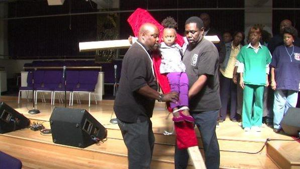 Larry Bishop mock-crucifies his granddaughter (Still via ABC 7 video)