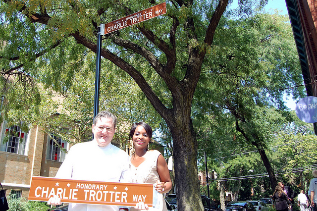 Charlie and Rochelle Trotter hold newly unveiled Honorary Charlie Trotter Way street sign (WBEZ/Louisa Chu)