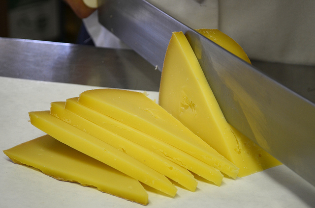 Cheesemaker Andy Hatch slices Pleasant Ridge Reserve at Uplands Cheese (WBEZ/Louisa Chu)