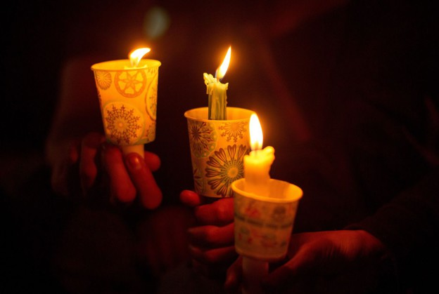 People hold candles during a vigil in Roseburg, Oregon on October 1, 2015, for nine people killed and seven others wounded in a shooting at a community college in Oregon. (Josh Edelson/AFP/Getty Images)