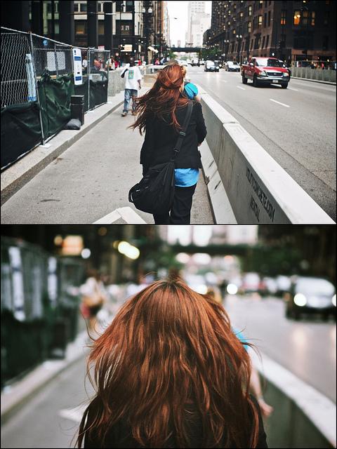 Woman walking near Dearborn during rush hour. (Flickr/Vonderauvisials)