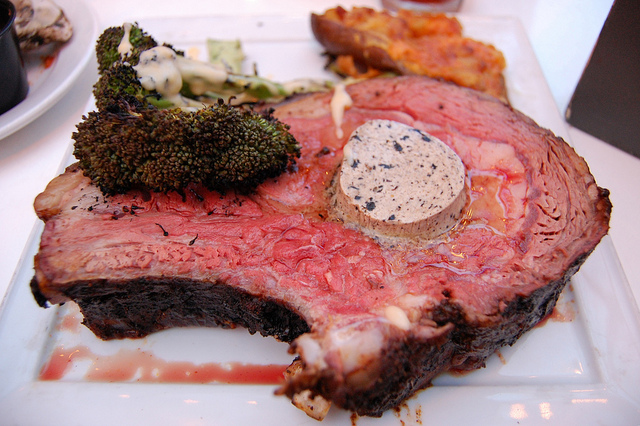 Smoked prime rib with black garlic butter; grilled broccoli with smoked cheddar cheese sauce; smoked twice baked potato with bacon and crème fraîche (WBEZ/Louisa Chu)