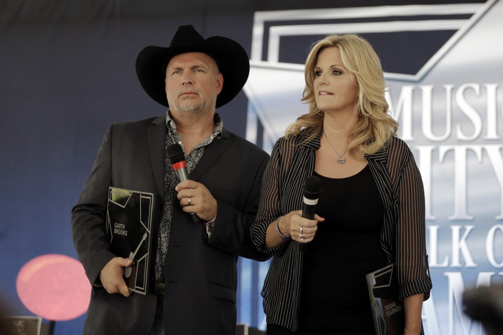Garth Brooks and Trisha Yearwood speak after receiving stars on the Music City Walk of Fame on Thursday, Sept. 10, 2015, in Nashville, Tenn. (AP Photo/Mark Humphrey)