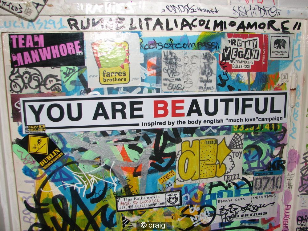 you are beautiful stickers are all over Bracelona biggin up the body english vibe!