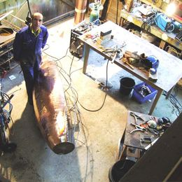 Michael Chaikin in studio with giant verdigris pot in early stages of construction