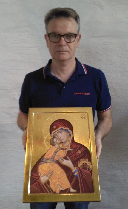 Holding The Vladimir Icon