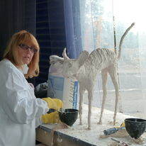 Lynn working on her cat sculpture