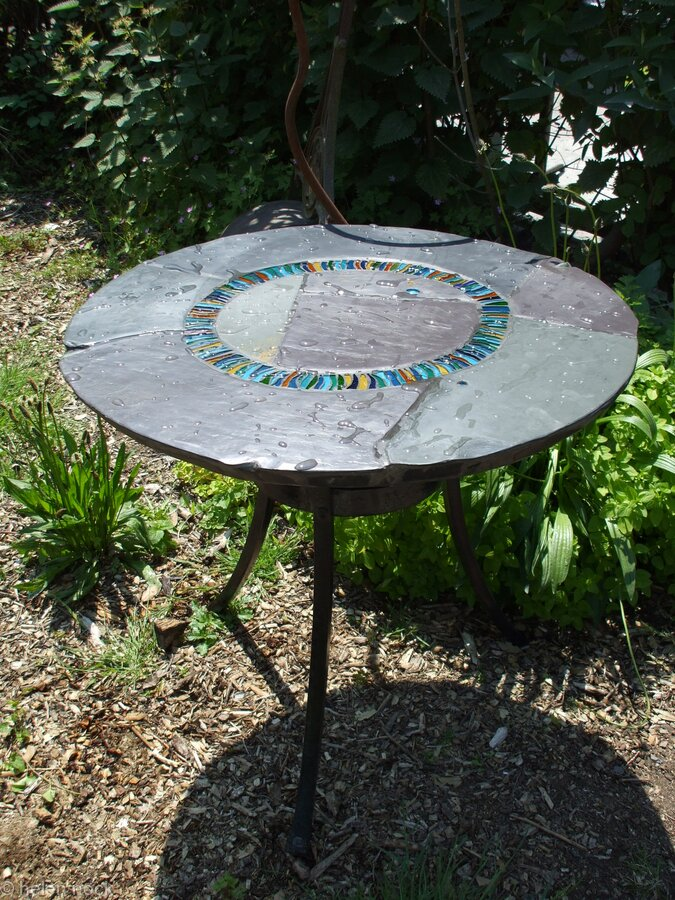 Wave Circle Design: hand made garden table on traditionally forged iron base