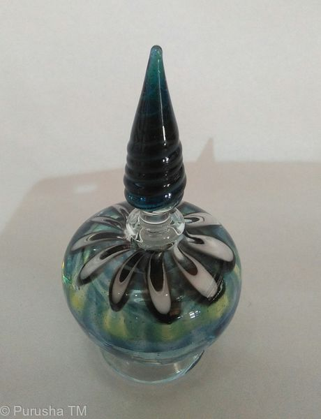 perfume bottle dark blue aqua stem with swirl and blue white floral base