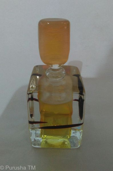 perfume bottle light gold round flat stem with square base light gold brown fleck