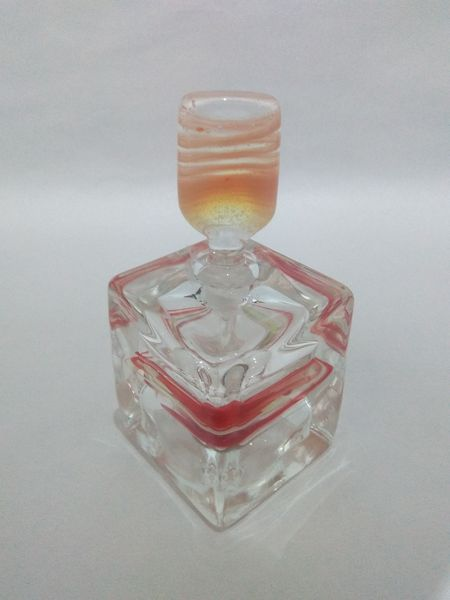 perfume bottle light pink gold round square stem with clear square base white red swirl