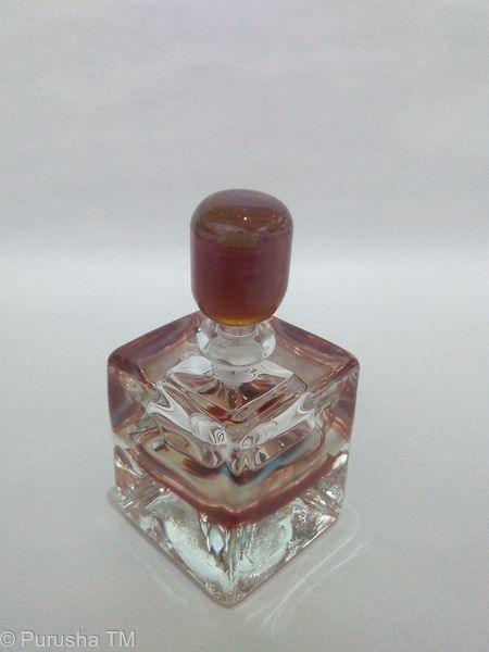 perfume bottle red honey round stem with clear diamond shape base brown blue purple white swirl