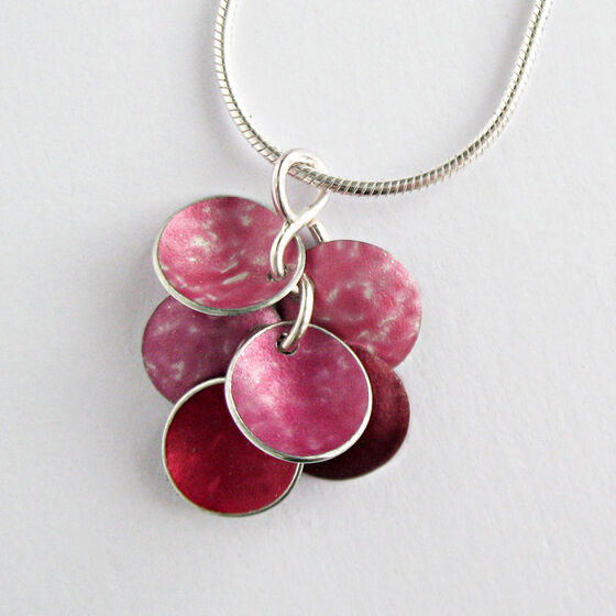 CD20 Six concave disc pendant in peach, pink and red.
