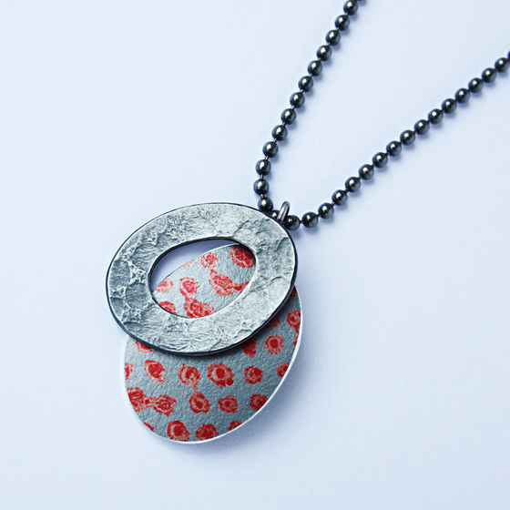 TS7 Oxidised silver hoop and red spot print oval pendant