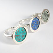 AL16 Silver circle ring pictured here with jade, blue and grey green centres