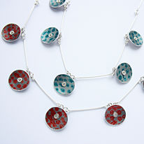 TS8 Five spot print disc necklace here in red and turquoise blue