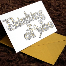 Thinking of you greeting card with gold envelope