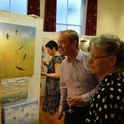 Tim Farron looking at Judy Evans' work