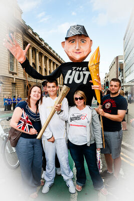 Giant Alan Olympic Torch bearer