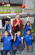 Berenice Bonallack photographed with the kids she is teaching to cook for Yours magazine