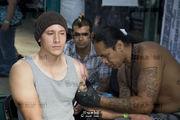 Man recieving a Samoan tattoo. London Tattoo Convention