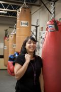 Nina, Robinson, producer BBC World Service. Photographed at a boxing club in Hackney where she is recording a series
