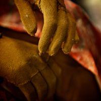 Detail of Mercy's hands.