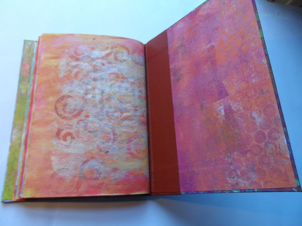 Hard back book of gelli print samples