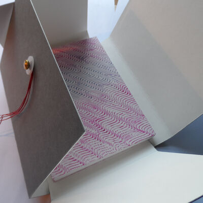 Phase box with coptic sewn book