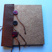 Concertina book with ribbon and button ties