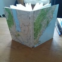 A commision made using maps of New Zealand on the covers, with a coptic style binding
