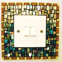 Mosaic light switch I made for my house to match the stair treads