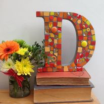Mosaic letter D in hot colours