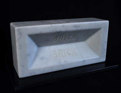 'Brick', Carved Carrara marble brick, life-size, on black granite base, individually numbered edition of 999, £500