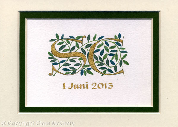 Gold letters handpainted with dark green leaves