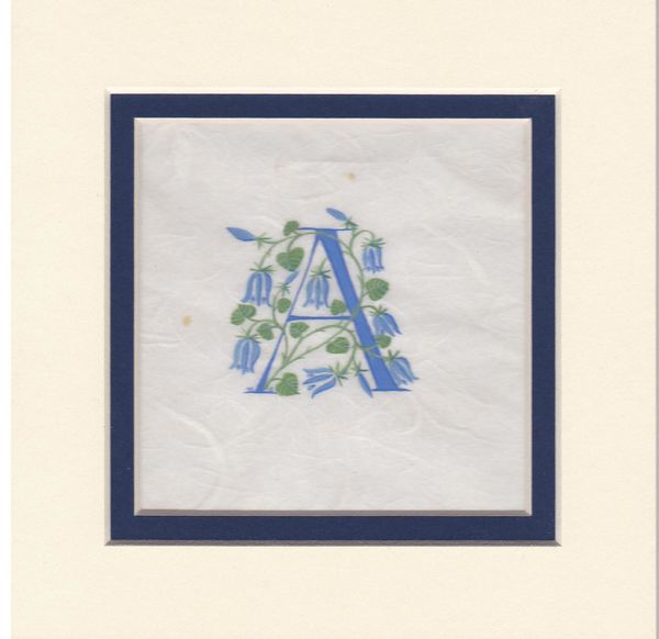 Initial A in dark blue with bluebells