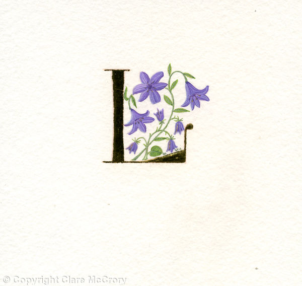 Letter L in 24c gold leaf with purple lilies