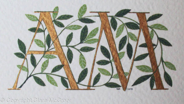 Two initials in gold with green leaves