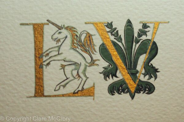 Gold letters with a unicorn and Florentine giglio