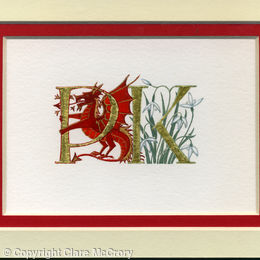 Double initials PK in gold leaf wth a red dragon and snowdrops