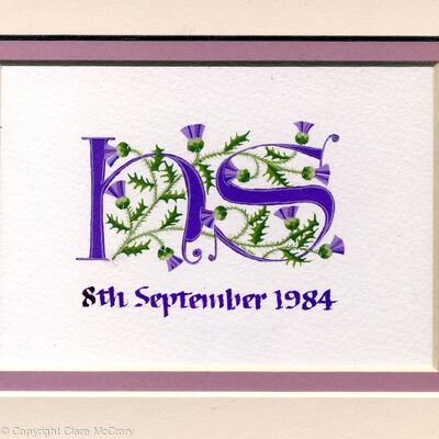 Two initials in purple with thistles on watercolour paper