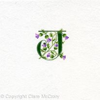 Letter J handpainted in green with Scots thistles