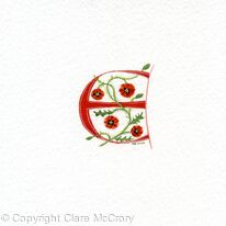Manuscript initial E in red with poppies