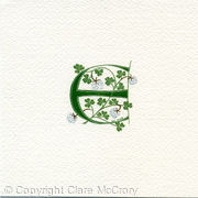 Letter E handpainted with white clover
